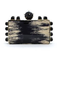 Jewel box: we're obsessed with the tiny clutch bag! From Tonya Hawkes