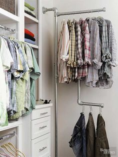 Industrial accents give this portion of the space a laid-back vibe and show off favorite clothing. Here, a wall-mount garment tree made of galvanized pipes looks cool and makes finding a favorite shirt a cinch.    /