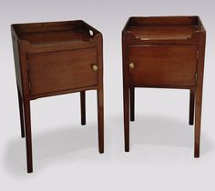 A Pair of George III period mahogany Bedside Tables, having galleried top with carrying handles above cupboard doors, supported on square legs. (With slight differences.) Circa: 1800 Ref: 5477