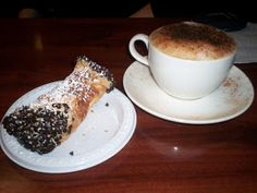 Cannoli and cappuccino
