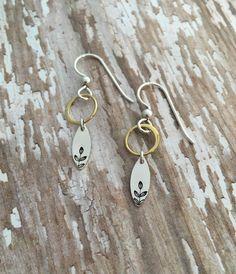 Metal stamped leaves earrings.