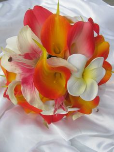 Destination wedding bouquet - plumeria, calla lilies, Casablanca lilies