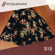 WOMENS Plus Size Multi-colored flowing skirt Long beautiful flowy multi-colored skirt (Mostly navy blue) with floral print through skirt mixed with burgundy,light pink, white & green-never worn  Material: 100% Polyester Magic Skirts Maxi