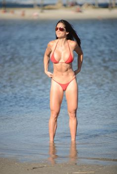Muy caliente! Michelle Lewin is so hot, she was in desperate need of a cool down -- the stunner took a dip in the ocean in a tiny red bikini that revealed her rock hard abs and stunning curves in Miami on March 24, 2014.