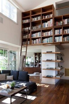 Apartment Ideas,Incredible Ideas To Design A Home Library In Lofty Apartment By Using Custom Floating Oak Book Shelves With Level Above Living Room Near Kitchen Featuring Sliding Ladder ,How To Wonderfully Design A Home Library For Book Enthusiast's Houses, Apartments, And Lofts