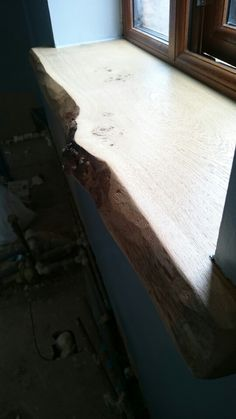 Chunky oak window sill with natural waney edge  Www.periodoakbeams.co.uk