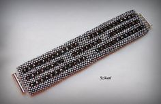Metallic grey cuff bracelet Statement beadwork bracelet by Szikati