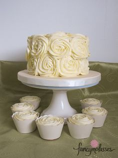 I'd like these roses covering every tier. Simple yet elegant. Nothing too over the top. I mean it's just a cake...it's going to be eaten