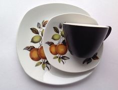 Midwinter Stylecraft Trio. Oranges & Lemons Pattern by John Russell in the 1960s The coffee cup is 5.5cms tall; the saucer is 12cms in diameter ; the tea plate is 16.5cms in diameter. In good condition with no chips or cracks, some crazing to the inside of the cup.