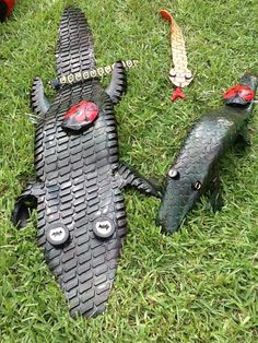 Recycled Tire Alligators with Recycled Tire Lady Bugs on their backs from www.cooltireswings.com