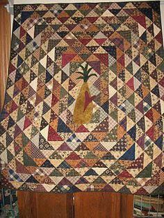 The quilt is Pineapple Pie by Sandy Gervais .  Made and discussed by Becky at this blog post: http://primitivesnstitchin.blogspot.com/2012/01/for-mary.html