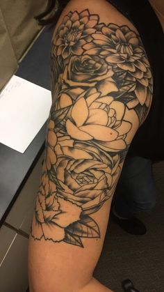 My tattoo, floral, half sleeve. Line work and shading done color still to come