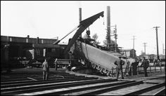 Rerailing tender of NP 5126 after sticking throttle caused tender to drop into the Missoula Turntable Pit. NP Wrecker 44 on duty.  Date: June 22, 1942       Location: Missoula, MT       Photographer: Ron V. Nixon  Railroad: Northern Pacific Railway       Station: Missoula --- USA