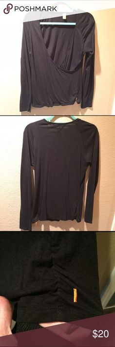 Lucy Wrap Top This is a wrap style top from Lucy, in pristine condition. The pictures don't do it justice! It's a thinner material, perfect for yoga. Size large and super soft. Has a cute ruched detail near the logo. Lucy Tops Tees - Long Sleeve