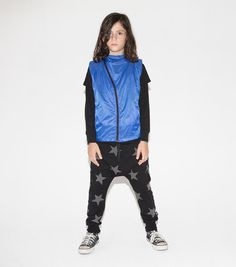 a little bit moto, a little bit space age. this shinyroyal blue retro-future vest comes with our asymmetrical front zip. relaxed for movement & maximum