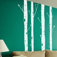 "Whether beside the doorway or adorning an accent wall, this forest-inspired decal fills your home with organic intrigue and eye-catching style. Product: 4 piece tree decal setConstruction Material: VinylColor: WhiteFeatures: Includes four tree branchesDimensions: 98"" H x 7"" W each"
