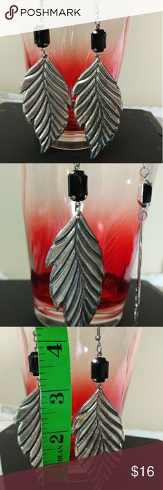 large lightweight Leaf feather earrings Approximately 4 inch drop lightweight earrings beautiful boho Bohemian style. Beautiful and fashionable. Automatically save 25% when bundling three or more items. Check out my other listings. Offers are welcomed and encouraged other Jewelry Earrings