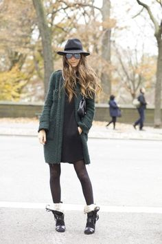 Arielle Nachami is wearing a green coat from Zara, black dress from Blesses Are The Meek, shoes from Isabel Marant, bag from Chanel and the hat is from TopShop