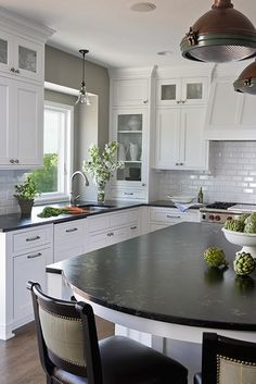 white cabinets, dark countertops