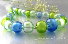 Hollow lampwork beads by Luda Marchenko