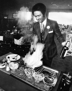 Fred L'arge, maitre d' in the Red Lion dining room, prepares a flambé, a specialty of the restaurant. This Aug. 17, 1980, photo ran with a World-Herald story about the Red Lion Inn taking over the Hilton Hotel. Red Lion was put to the test early, hosting a national convention of 3,500 people within the first eight days of taking over. THE WORLD-HERALD