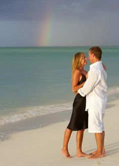 on the beach at Parrot Cay in Margiela Martin Margiela - engagement photo