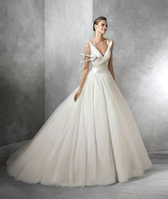 Tulle and Satin Gown - 24 Elegantly Tailored Wedding Dresses for Pear Shaped Body - EverAfterGuide