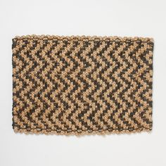Woven from rugged, durable jute with herringbone stripes, this handmade doormat is a geometric addition to indoor and outdoor entryways alike.- Handmade- Jute- Indoor or outdoor use- Imported3'W, 2'L