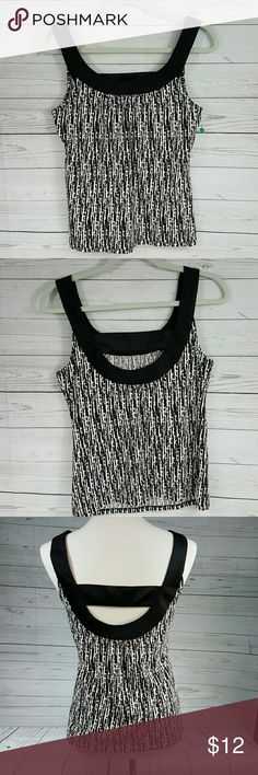 Ann Taylor top Sophisticated Ann Taylor top. Versatile for work as base layer or alone for more casual times.  96% cotton, 4% spandex. Black and white print is cotton blend, black band has a satin feel. Ann Taylor Tops Tank Tops