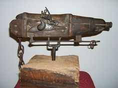 The gun, which the museum dates to 1710, is mounted on a mechanism that allows it to spin freely. Cemetery keepers set up the flintlock weap...
