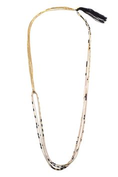 The Atacama Necklace is composed of two linked segments. One part entirely gold, the other a mix of pink, ivory, gold and black. The longer segment can be adjusted to create one uniform length of 4-st