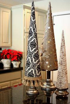 Just made a dozen and a half of these type trees using upholstery fabric. Soooo easy using poster board to make the cone shaped tree and then visited thrift stores to find big and bold candlestick holders. Will be centerpieces for holiday food table. So much fun and really easy to do!