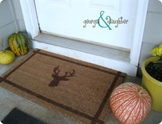 Add a touch of fall to your front door with a stenciled doormat like one with antlers that was inspired by Ballard Designs.