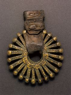 Africa | Sun pendant from the Dogon people of Mali | Bonze alloy and leather