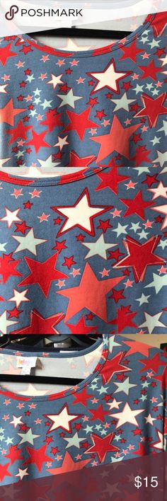 LULAROE IRMA L BLUE BACKGROUND WITH WHITE AND RED LULAROE IRMA L BLUE BACKGROUND WITH WHITE AND RED STARS. PATRIOTIC!! EUC. RUNS LOOSE. LuLaRoe Tops Tunics