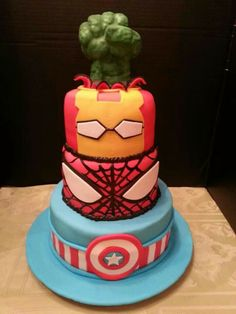 Superhero birthday cake with Captian America, Spiderman, Ironman, and Hulk fist