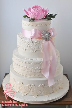 Elegant lace inspired wedding cake with gumpaste peony by Cookie Cornucopia.