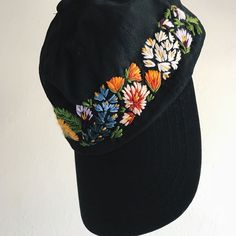 My hats aren't usually this elaborate but this is a specialized custom order for Lauren, who fell in love with the first hat I ever embroidered and wanted to order something similar. I love love the flowers wrapping around the front and sides, gonna need to make something like this for myself, STAT. Also this style of layout will be available in my next round of listings! Reopening on Monday 1/22 ☺️ #embroidery #floralembroidery