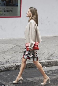 Queen Letizia shows off an eye-catching skirt at mental health confederation in Madrid   Daily Mail Online