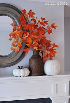 Freshly cut bright leaves and faux pumpkins painted ballet white...simple, yet lovely for the mantle!
