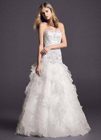 """The epitome of alluring beauty and exquisite design, this beaded organza wedding dress is """"the one""""!  Strapless beaded organza ball gown features luxurious embroidered lace bodice.  Striking drop waist and dramatic ruffled skirt will have all eyes on you.  Chapel train. Sizes 0-14.  Ivory available online and in stores.  Fully lined. Back zip. Imported polyester. Dry clean.  To preserve your wedding dreams, try our Wedding Gown Preservation Kit."""