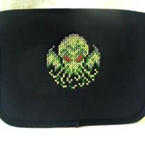 Up for sale is a padded nylon case for iPad Minis, Kindles, e Readers and other tablet computers.   This black iPad case/cover has been hand cross stitched by me with a large, brightly colored Cthulu design  This tablet case measures 8.5 x 6.5 inches, and will fit up to an 8 x 6 inch device. ...