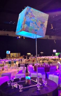 A wrapped cube stand - featuring a world map! Let Holliday's custom design and print additions to your next event.