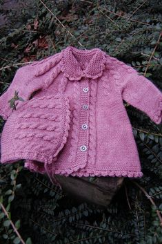 "Jacket and bonnet in ""Merino Extra Fine"" with cables pattern by DROPS design - ages 3 mos. to 4 yrs."