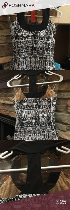 Lululemon Dance Scoop Neck Top Lululemon black and white dance scoop neck top size 8 in EUC. Not sure of style name, let me know if you do!:) lululemon athletica Tops