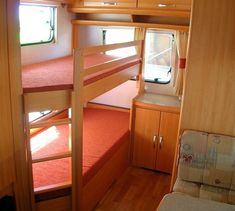 Caravan bunk beds = would work well in a tiny house on wheels. The angle where the ladder is allows for easier entry into a tight space.