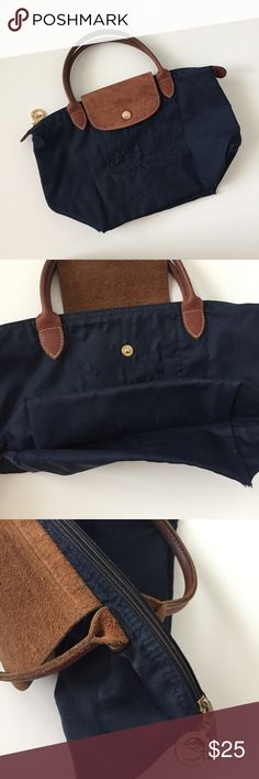 longchamp navy mini le pliage tote navy blue and brown le pliage tote mini, well loved but still in good condition, corners slightly worn and gold zipper is faintly fading (zipper itself not the hardware charm) Longchamp Bags Mini Bags