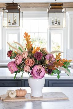 Create a stunning Thanksgiving centerpiece this year with artificial flowers that look real. Simply choose your favorite fall blooms and artificial greenery stems and style like a pro. Shop fall leaves and flowers at Afloral.com.