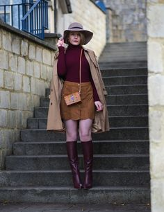 Burgundy Knee High Boots With A Suede Skirt And Roll Neck Top I'm back with a new outfit to share with you! Finally! This is one that I have had planned for about a month actually (which is w…