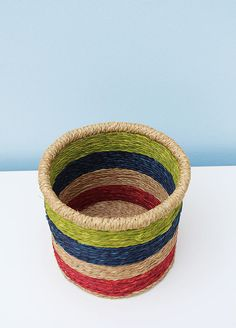Beautiful grass-woven African basket: this basket is modern in appearance using hand-dyed grass woven into bands of red, blue and green